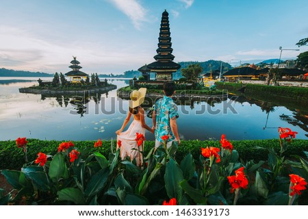 Couple spending time at the ulun datu bratan temple in Bali. Concept about exotic lifestyle wanderlust traveling Royalty-Free Stock Photo #1463319173