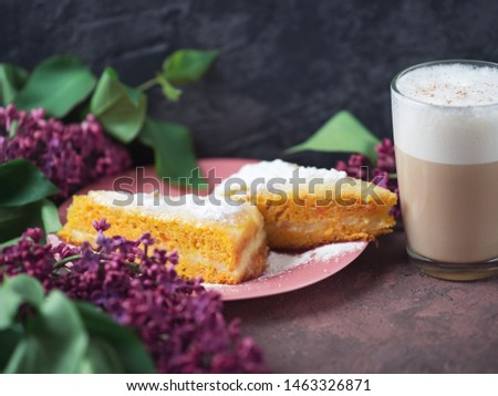 Coffee latte in a glass glass glass glass with a piece of cake cozy atmospheric background with flowers #1463326871