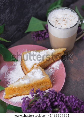 Coffee latte in a glass glass glass glass with a piece of cake cozy atmospheric background with flowers #1463327321