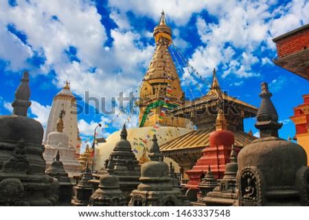 Swayambhunath stupa along with Harati Devi's temple and small stupas and pagodas in the foreground. Landscape of Swayambhunath or Monkey temple in Kathmandu, Nepal. #1463337548