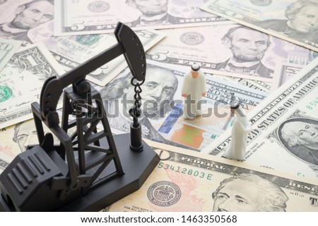 Spending or investment of a country's revenues from petroleum exports industry (Petrodollar). Oil pump jack and arab men on US dollar banknotes. Concept of crude oil production, petroleum industry. #1463350568
