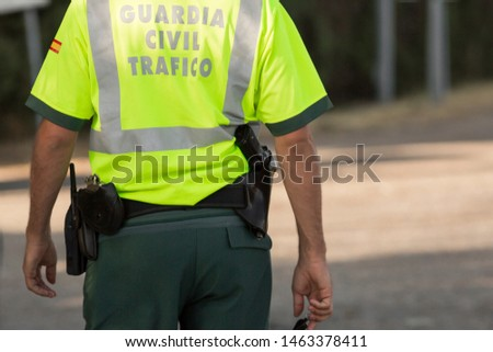 View of the back of a civil traffic guard in Madrid, Spain. (Civil traffic guard) #1463378411