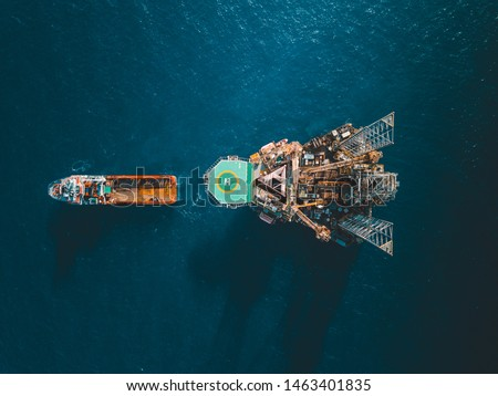 Aerial view of jack up rig with towing vessel during towing operation Royalty-Free Stock Photo #1463401835