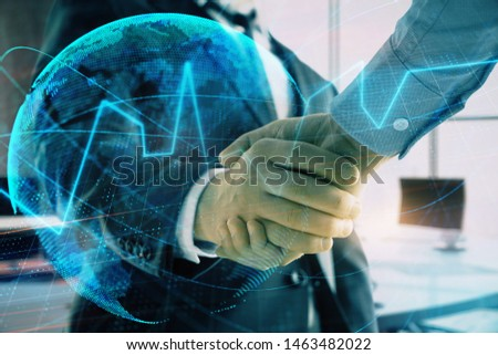 Multi exposure of financial chart and map on office background with two businessmen handshake. Concept of success in business #1463482022