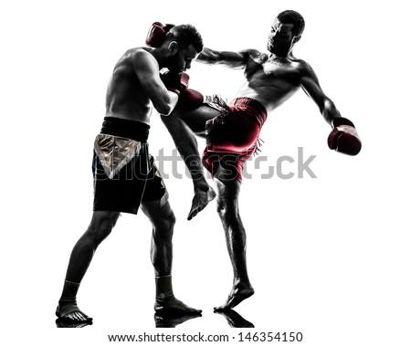 two caucasian  men exercising thai boxing in silhouette studio  on white background Royalty-Free Stock Photo #146354150