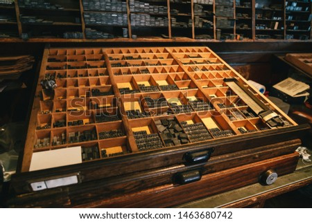 Close up of metal letters for the reconstructed wooden Gutenberg's printing machine used for printing souvenir post cards with sealing wax stamps. Located in souvenir shop, museum in the Bled Castle