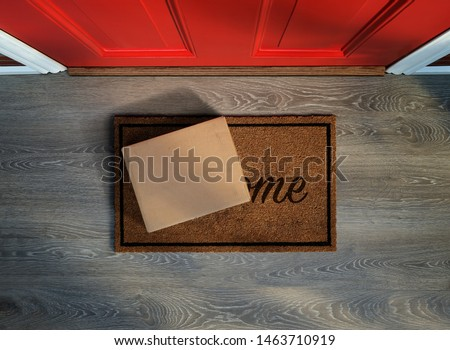 Delivered outside the door, e-commerce purchase on welcome mat. Add your own copy and label Royalty-Free Stock Photo #1463710919