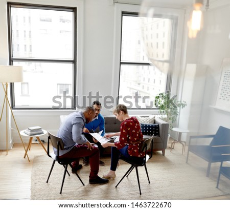 Multi-ethnic team of creative millenials collaborating on a brainstorm project #1463722670