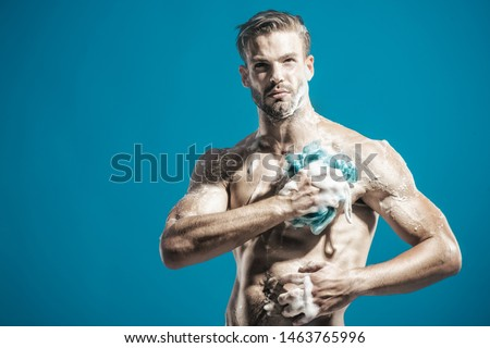 Body care, skin care, cleaning concept. Male taking shower in bathroom. Sexy man with naked body washing with sponge. Muscular man in shower. Morning hygiene. Handsome bearded man washing in shower. #1463765996