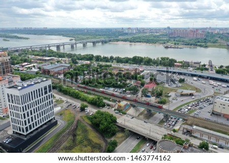 Novosibirsk city, Ob river, electric train rides by rail, panorama #1463774162