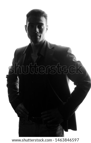 Afro American business man portrait silhouette in black blazer on white isolated background.