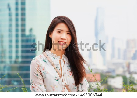 Asian woman with City view at Bangkok, Thailand. #1463906744