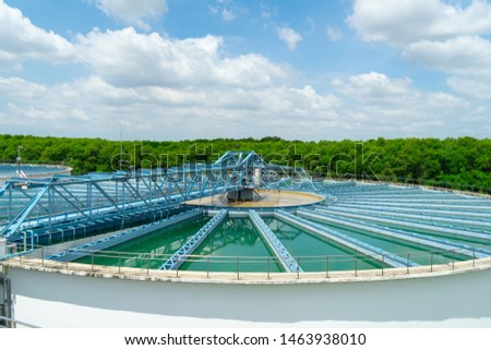 Water treatment,the process of making raw water to clean by putting chemicals in the machines,processing of the solid contact clarifier sediment tank.Wastewater Treatment Plant with steel structure. #1463938010
