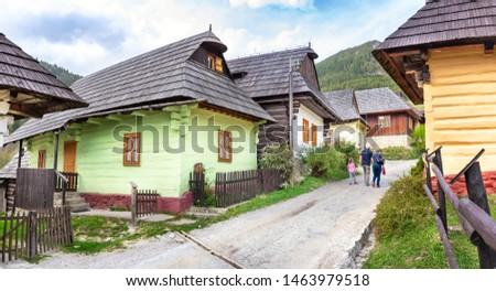 People walking through traditional mountain village Vlkolinec - UNESCO (SLOVAKIA) #1463979518