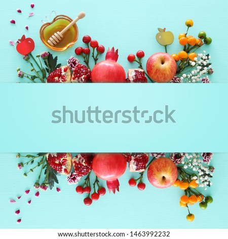 religion image of Rosh hashanah (jewish New Year holiday) concept. Traditional symbols over wooden mint blue pastel background #1463992232