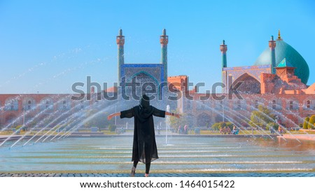 Beautiful Iranian girl wearing abaya with arms up happy - Shah (Imam) Mosque (Jameh Abbasi Mosque), Imam mosque in Naghsh-i Jahan Square - Isfahan, Iran, #1464015422