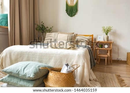 interior of stylish loft. spacious apartment with large windows, parquet on the floor and light walls. modern furniture in blue Scandinavian style. free space planning with sitting area and rest area #1464035159