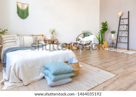 interior of stylish loft. spacious apartment with large windows, parquet on the floor and light walls. modern furniture in blue Scandinavian style. free space planning with sitting area and rest area #1464035192