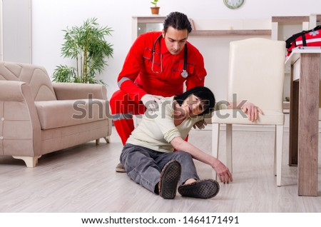 Young doctor examining senior old woman #1464171491