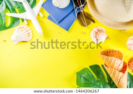 Travel and vacation flatlay concept. Summer bright colorful background with hat, sunglasses, plane,  passport, tropical leaves, travel cosmetics kit, seashells, copy space top view banner #1464206267