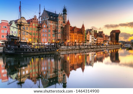 Gdansk with beautiful old town over Motlawa river at sunrise, Poland. Royalty-Free Stock Photo #1464314900