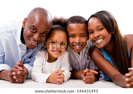 Happy family smiling and lying on the floor - isolated over white #146431493