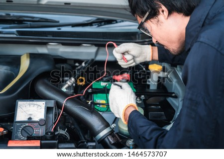 Professional car mechanic working in auto repair service. #1464573707