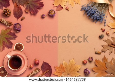 Autumn Flat lay composition. Cup of tea, autumn dry leaves, roses flowers, lavender, orange circle cones decorative pomegranate cinnamon sticks on brown pink background top view. Autumn, fall concept