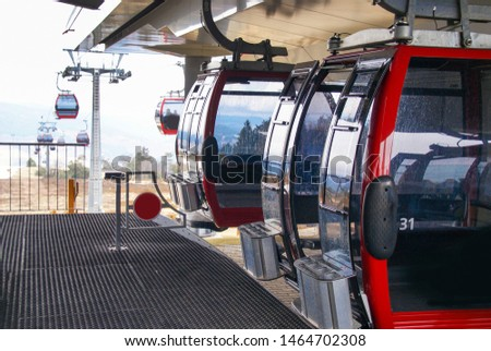 A ski lift with a number of gondolas on a cable for passenger transport in the mountains of holidaymakers with a snow destination in Willingen, Germany #1464702308