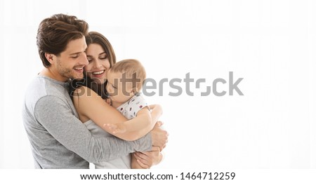 Perfect life. Adorable millennial family embracing, white panorama with empty space #1464712259