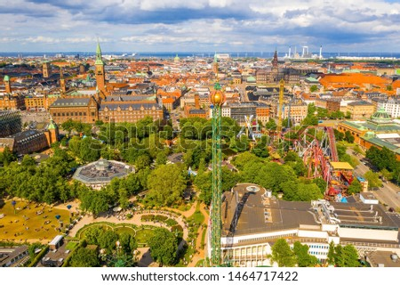 COPENHAGEN, DENMARK - JUNE 2019 - Aerial view of the Tivoli Gardens amusement park with people, visitors, attractions and rides. Urban view of the city of Copenhagen in Denmark, Europe #1464717422