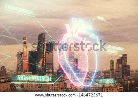 Multi exposure of human heart hologram on Moscow cityscape background. Concept of medical education #1464723671