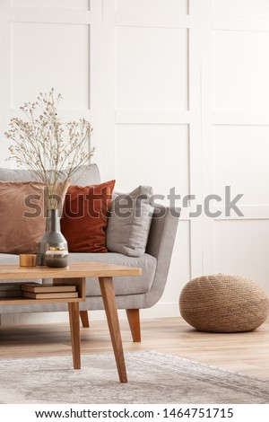 Wooden furniture and grey scandinavian sofa with pillows in beautiful living room interior #1464751715