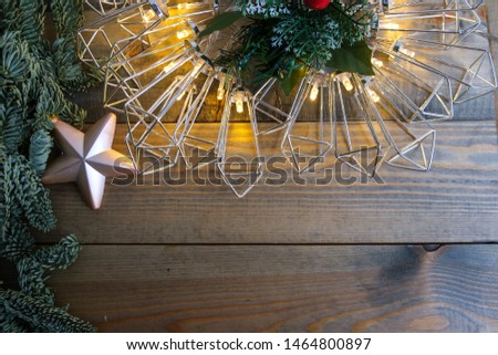 Christmas decoration with fir tree and garland lights on old wooden background. #1464800897