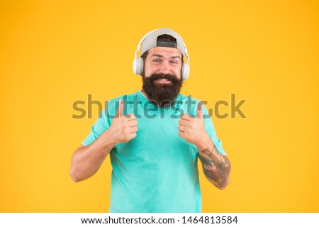 Lifestyle music fan. Man listening music wireless headphones. Hipster headphones gadget. Inspiring song. Music library. Bass low sound. Party every day. Rhythm of life. Bearded guy enjoy music. #1464813584