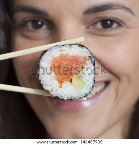 woman with sushi in front of her nouse #146487905