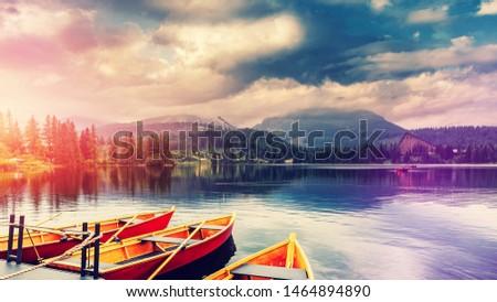 Amazing lake Strbske Pleso during Sunrise. Creative image. Wonderful Autumn landscape. Picturesque view of nature. Amazing natural Background. Popular Travel Destinations. High Tatras. Slovakia