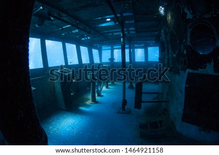 The USS Kittiwake, one of the best-known wreck dives in the Caribbean Sea, now lies empty. The 251-foot long ship was sunk off the coast of Grand Cayman in 2011 in order to create an artificial reef. #1464921158