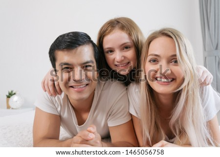 Portrait happy family spending time together on bed in bedroom. family and home concept #1465056758