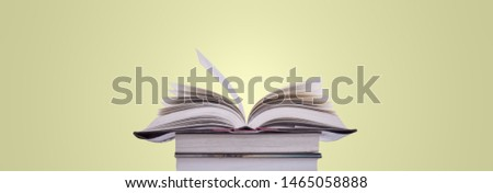 Book stack in the library and blurred bookshelf background for education. education background. back to school concept. #1465058888