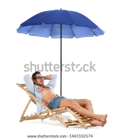 Young man on sun lounger under umbrella against white background. Beach accessories #1465102574