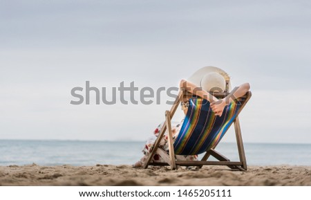 Summer beach holiday, Young asia woman relaxing on beach chair arm up her hand with floppy hat At Pattaya, Thailand #1465205111