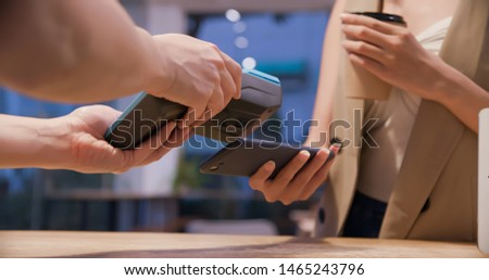 mobile payment concept - close up of Young woman pays by contactless phone to credit card system for her order coffee in the cafe #1465243796