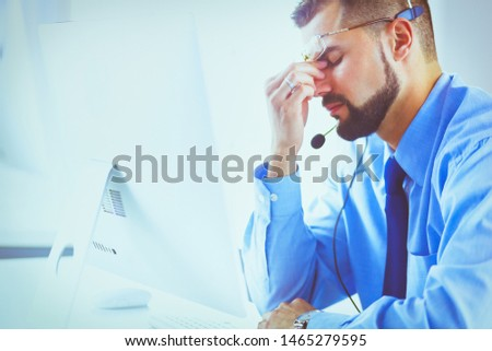 Handsome businessman unhappy with excessive work in the office #1465279595