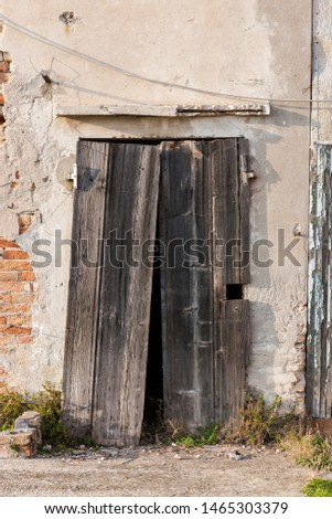 Door in an abandoned house somewhere in Italy #1465303379