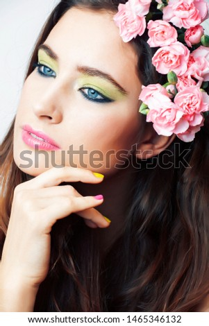 young pretty brunette woman with pink flowers and manicure posing cheerful isolated on white background closeup #1465346132