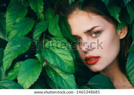Beautiful woman green leaves charm lips makeup exotics #1465348685