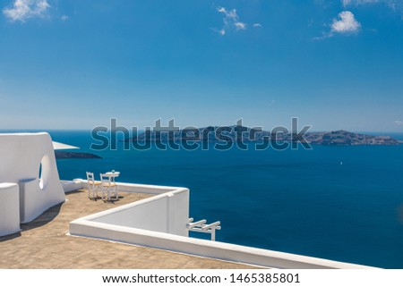 Beautiful travel background, two white chairs with white architecture on Santorini island, Greece. Luxury vacation scenery and summer holiday concept. Perfect tourism landscape, caldera with sea view #1465385801