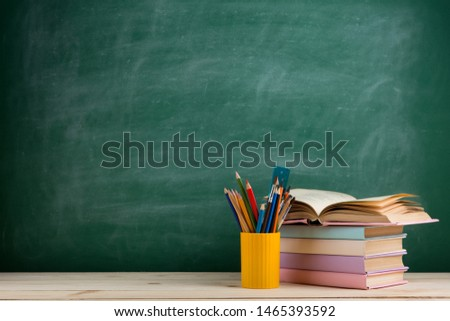 Education and reading concept - group of colorful books on the wooden table #1465393592