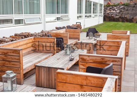 Outdoor restaurant terrace with wooden furniture in scandinavian style. Eco-friendly authentic design. #1465480292